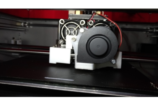 My self designed blower part cooling fan mount for the BIBO 3D Printer.